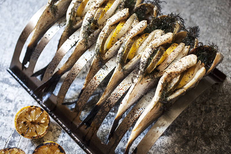 When cooking a fish in this manner, stuffing it with your favourite herbs and aromatic fruits and veggies is a great way to impart a subtle flavour. Use things like dill, lime, lemon, onion and garlic or any of your favourites.