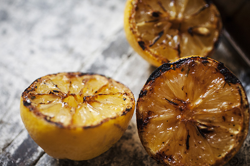 Lemon halves (or any sour citrus fruit for that matter) grilled over the flame not only tames their tartness but enhances their natural sugars, making them a perfect accompaniment to any grilled fish dish.