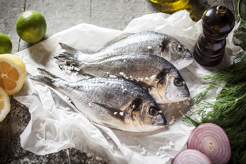 Fresh sea bream that will be stuffed with a selection of herbs and aromatic fruits and vegetables.
