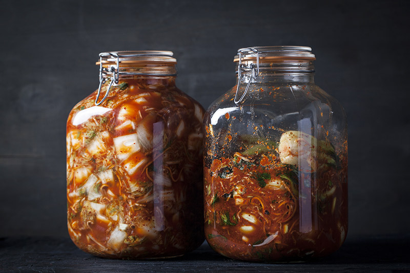 These are two types of Kimchi that I prepared at home and have fermenting in jars. The fermentation process happens quite quickly with Kimchi, a matter of 2-3 days depending on the temperature, after which time the Kimchi can be placed in the fridge where it will last for up to a year. Remember that when fermenting in glass jars as shown above, to be sure to open the jars at very regular intervals (every 8 hours or so) to release the gas build-up. Cover the lid of the jar with a cloth before opening to prevent gas from shooting Kimchi all over your kitchen; as was my first experience!