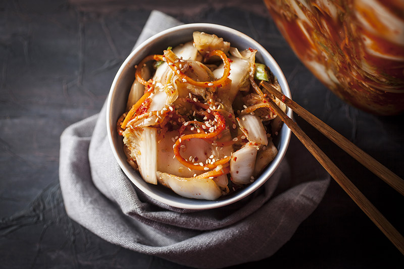"Traditional ""Baechu Kimchi"" made from Chinese/Napa cabbage. Kimchi can also be eaten as soon as it's made and before the fermentation process begins to sour the vegetables, as seen above. Sprinkle with sesame seeds and drizzle with toasted sesame oil before serving. Delectable! Click on the picture for how to prepare Kimchi yourself."