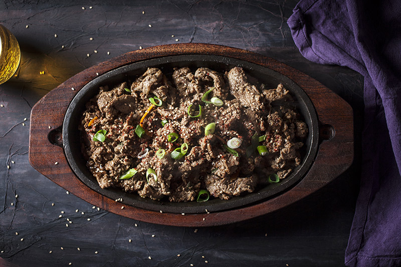 """Bulgogi"", Korean style beef from the grill. If you have one, use a cast iron sizzling skillet you can heat on the barbie to keep your dish warm long after it's come off the grill. Click on the picture for the recipe."