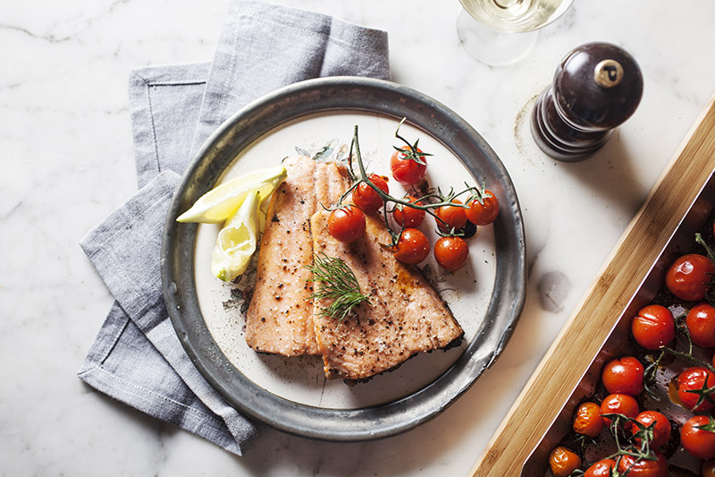 Serve the fish with the tomatoes and a fresh sprig of the herb you used to cook it. You can also serve it with a fresh bowl of herbed butter for dipping.