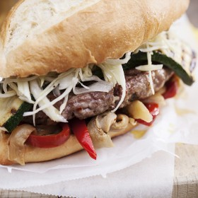 Grilled Italian sausage burger with marinated eggplant, grilled pepper, zucchini and fresh cole slaw. Spectacular!