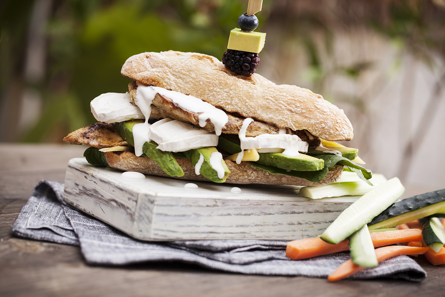 Cumin and lemon marinated grilled chicken sandwich with goat cheese, avocado and crème fraîche. Refreshingly delicious!