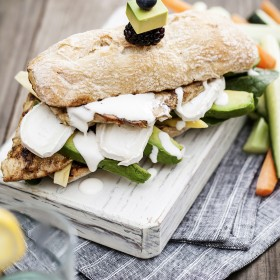 Grilled chicken sandwich. Cuming and lemon marinated grilled chicken sandwich with goat cheese, avocado and crème fraîche. Refreshingly delicious!
