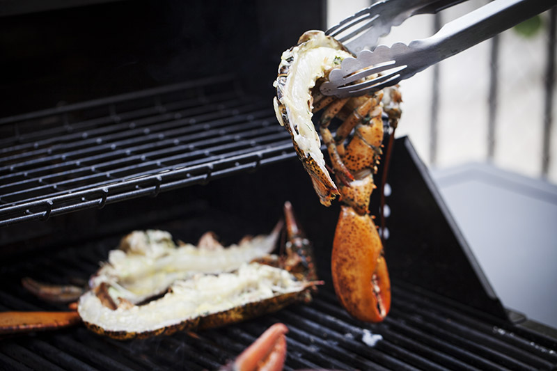 With the grill at maximum heat, add the lobster halves. Using tongs, place them shell-side down on the grill. If you aren't already using cast iron grills, which are far superior to stainless steel in my opinion, you can check them out by clicking on the image above!