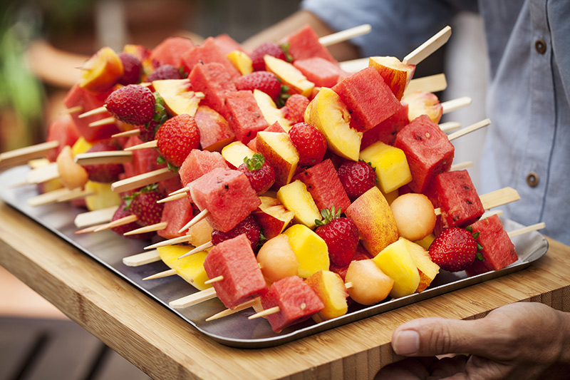 Begin with something light like the fruit skewers above. Simply load the full of mango, moon balls, strawberries, watermelon and whatever else you may like. Be sure to buy fruit that's a little underripe. The reason for this is that when grilling them, they will soften and the natural sugars will exude .