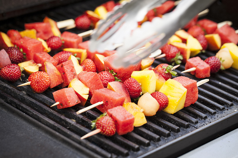 Grill the fruit skewers of medium heat until they start to sweat. Stay close to the bbq to make sure the sugars don't burn.