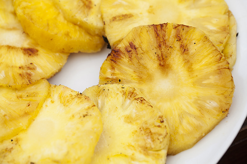 When half of the skewers are done and there's room on the grill, it's time for the pineapple!