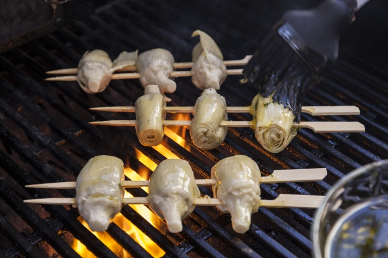 Finally, grill the artichoke hearts and baste them occasionally with the herbed oil from before.  Grill until you have nice grill lines and they are warmed through. These don't need to be hot!