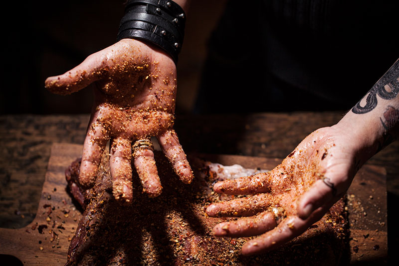 Get dirty! It's a rub so you really want to get in there and massage the meat fully.